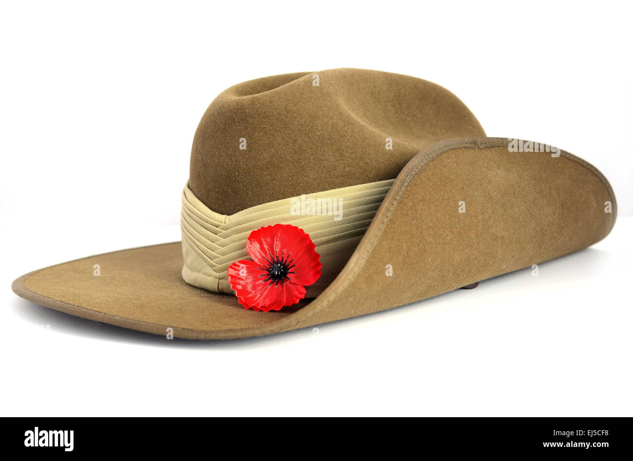 Anzac Day army slouch hat with red poppy on white background. - Stock Image