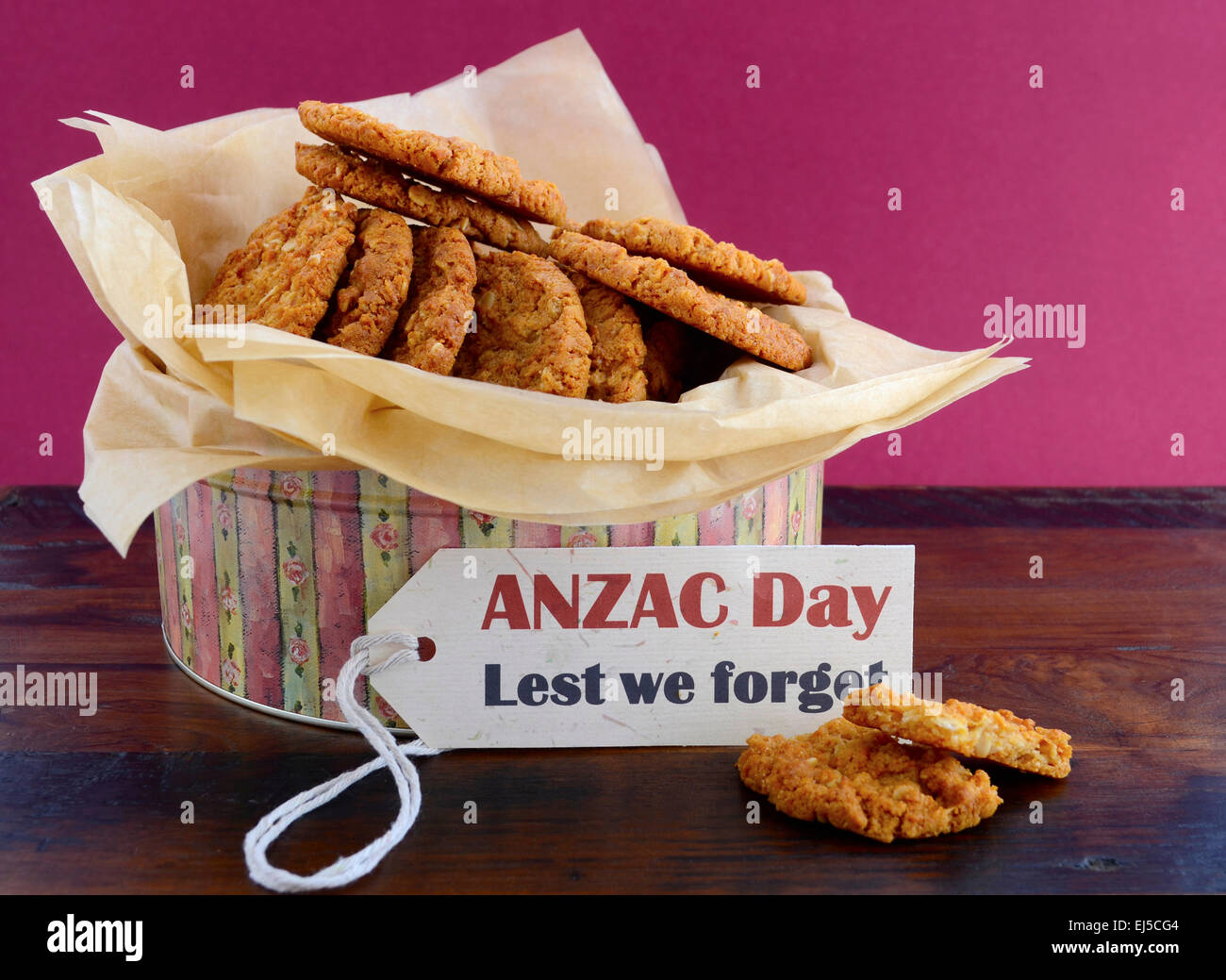 Australian Anzac biscuits in vintage biscuit tin container with Lest We Forget message. - Stock Image