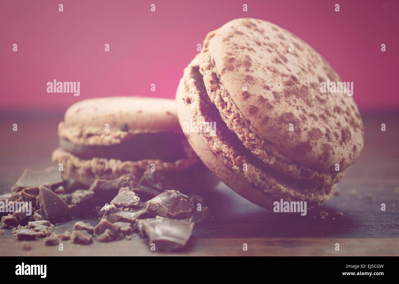 Chocolate Macaroons, with applied retro vintage style filters. - Stock Image