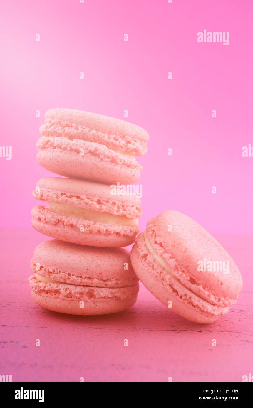 Strawberry flavor macaroons with applied lens flare style filter. - Stock Image