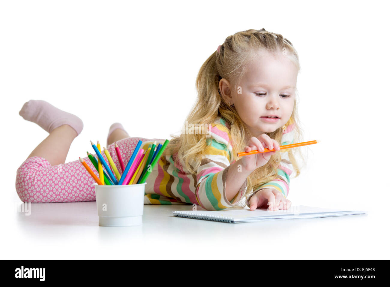 child girl drawing with pencils in nursery - Stock Image
