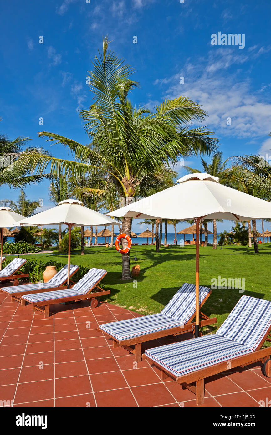 Lounge chairs at Vinpearl Resort. Phu Quoc island, Vietnam. - Stock Image