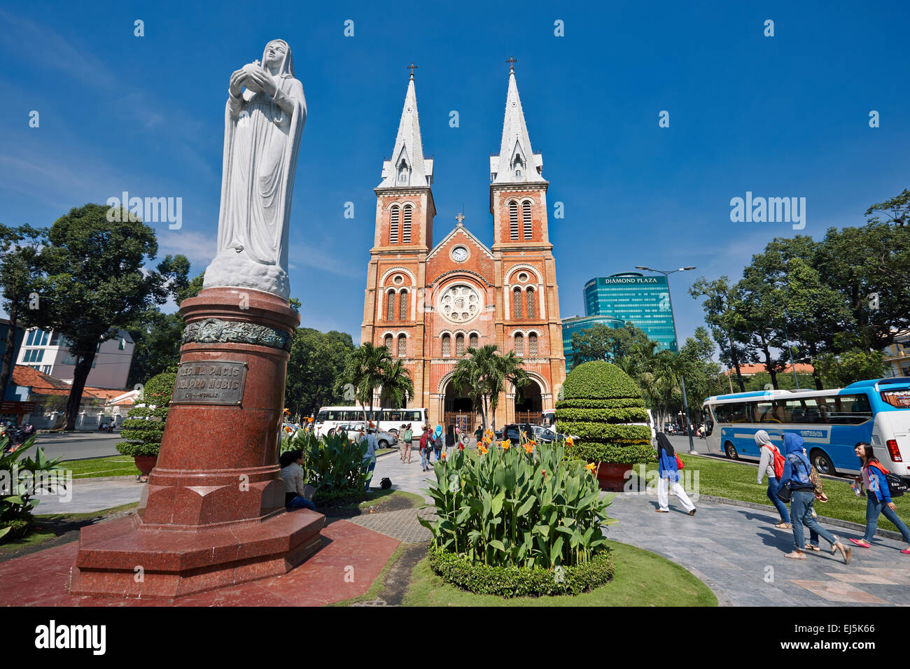 Regina Pacis, granite statue of Our Lady of Peace in front of Notre-Dame Cathedral Basilica of Saigon, District - Stock Image