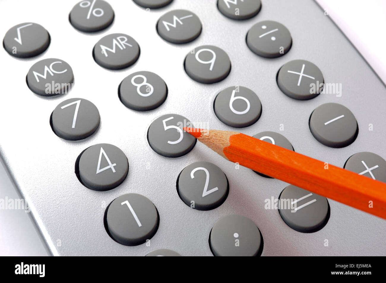 Financial business calculation with calculator and red pencil - Stock Image