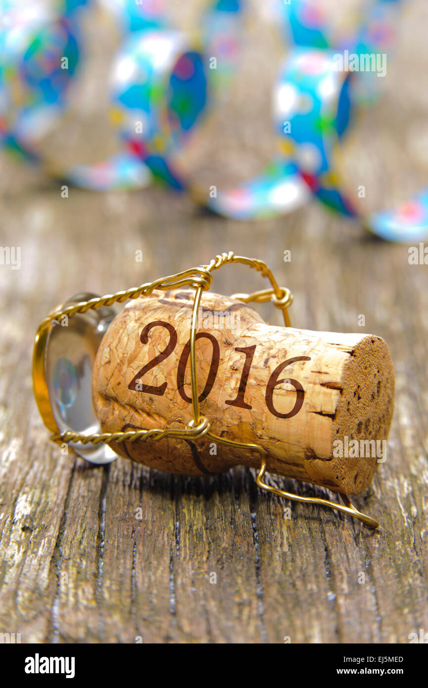 Happy new year 2016 with champagne cork at party - Stock Image