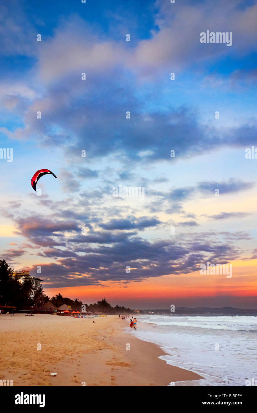 Beach at sunset. Mui Ne, Binh Thuan Province, Vietnam. - Stock Image