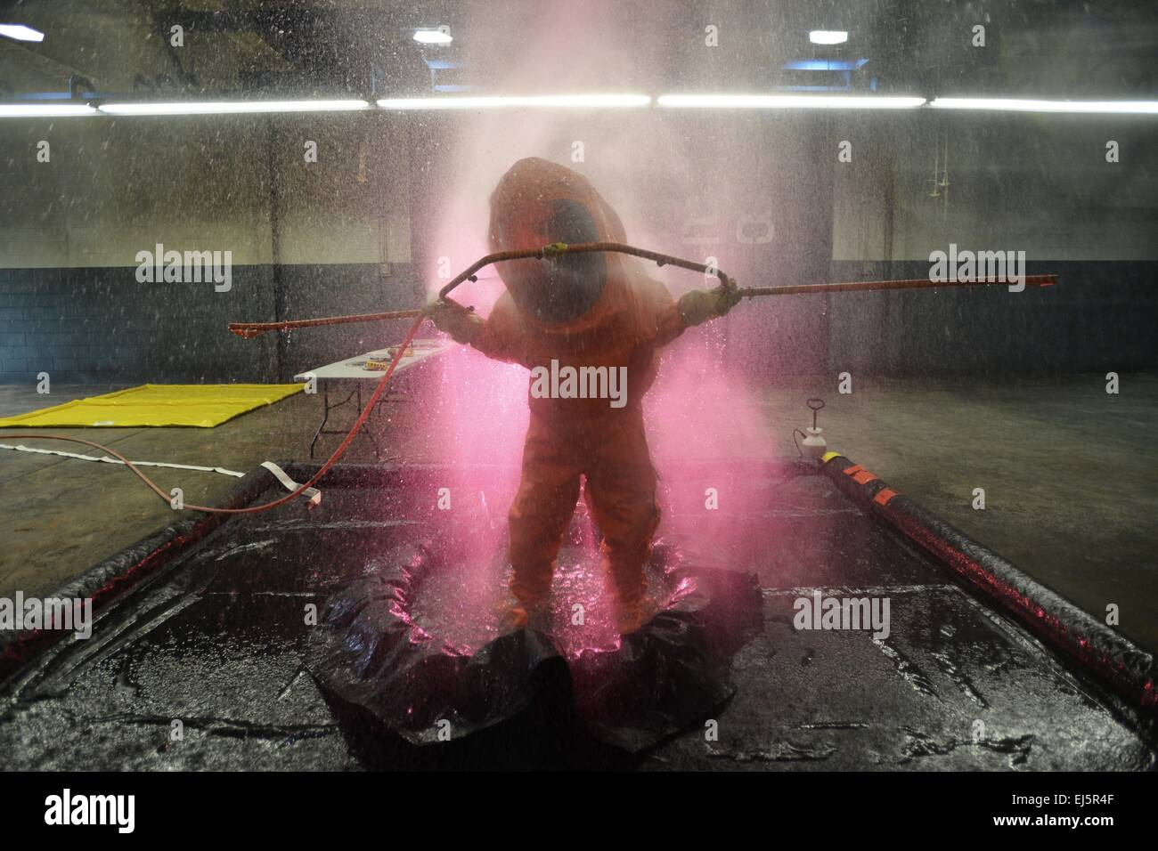 A US Air Force airman is decontaminated during multiple biological contaminants simulation training March 18, 2015 - Stock Image