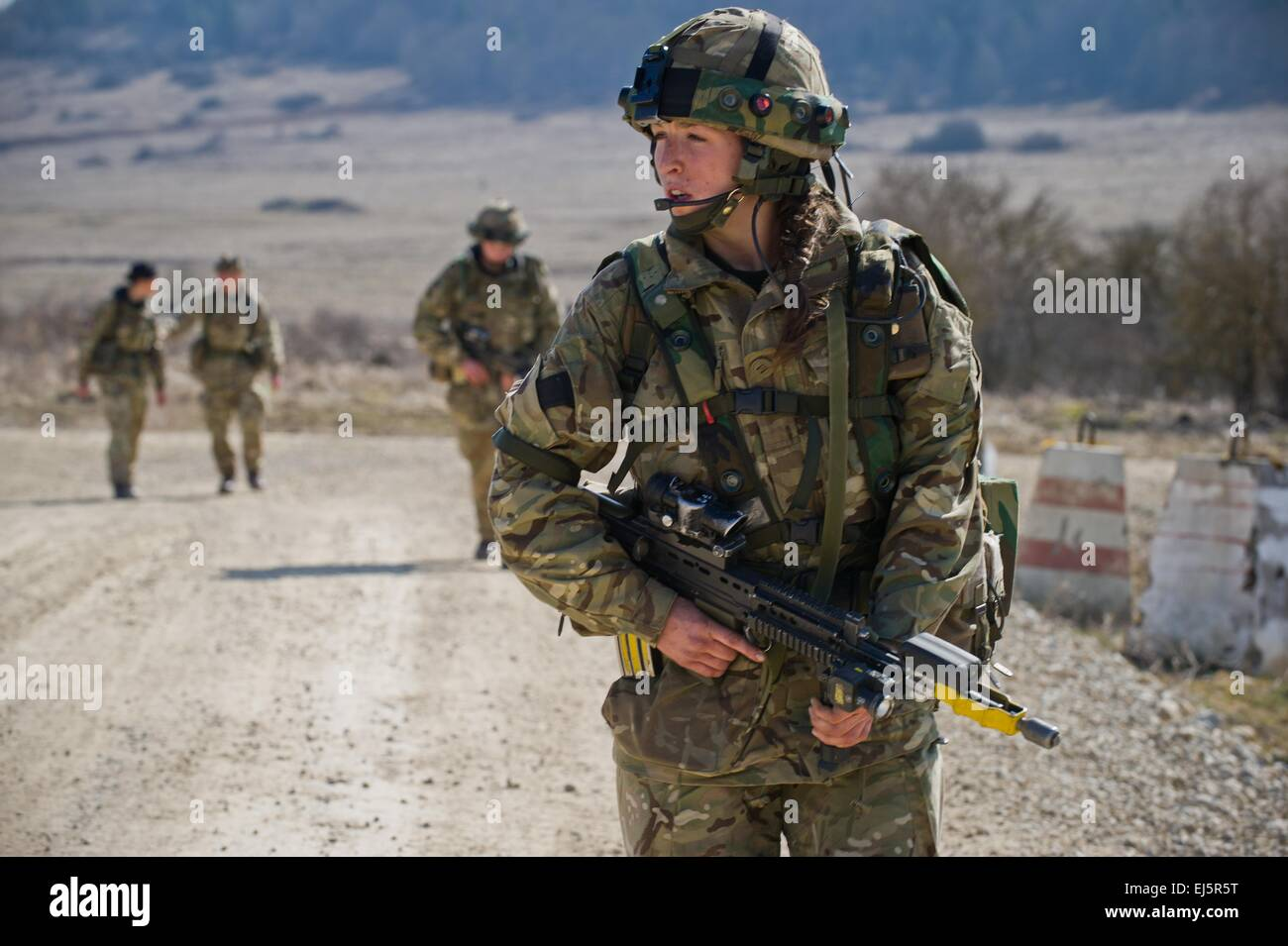 A British cadet of the Royal Military Academy Sandhurst yells to fellow cadets during final evaluation and validation - Stock Image