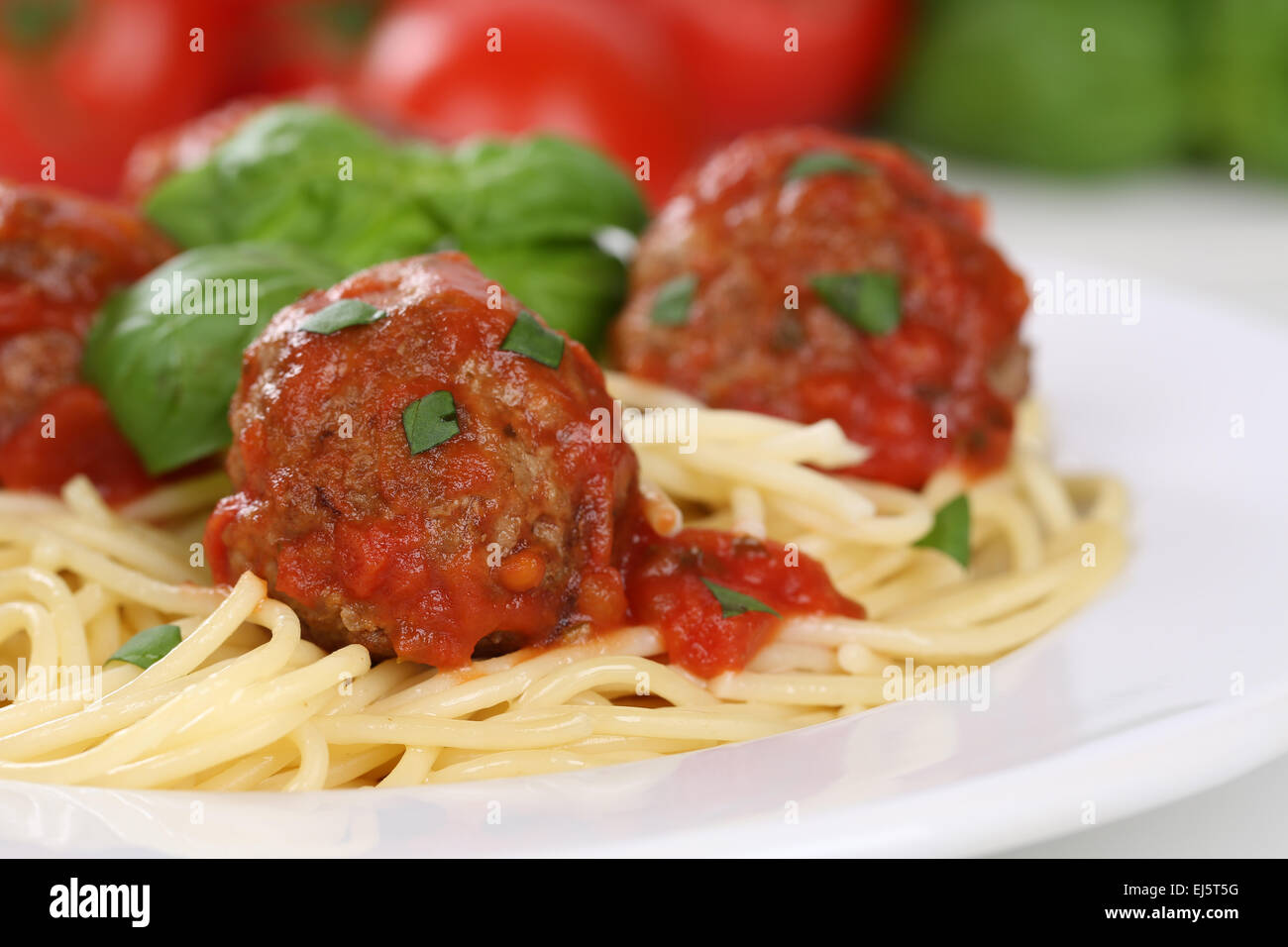 Spaghetti with meatballs noodles pasta meal on a plate - Stock Image
