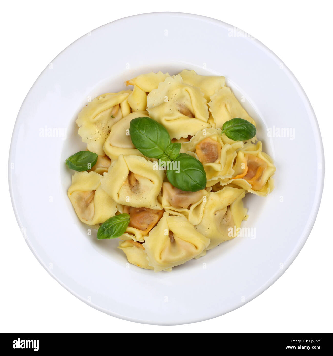 Italian Pasta Tortellini noodles meal with basil isolated on plate - Stock Image