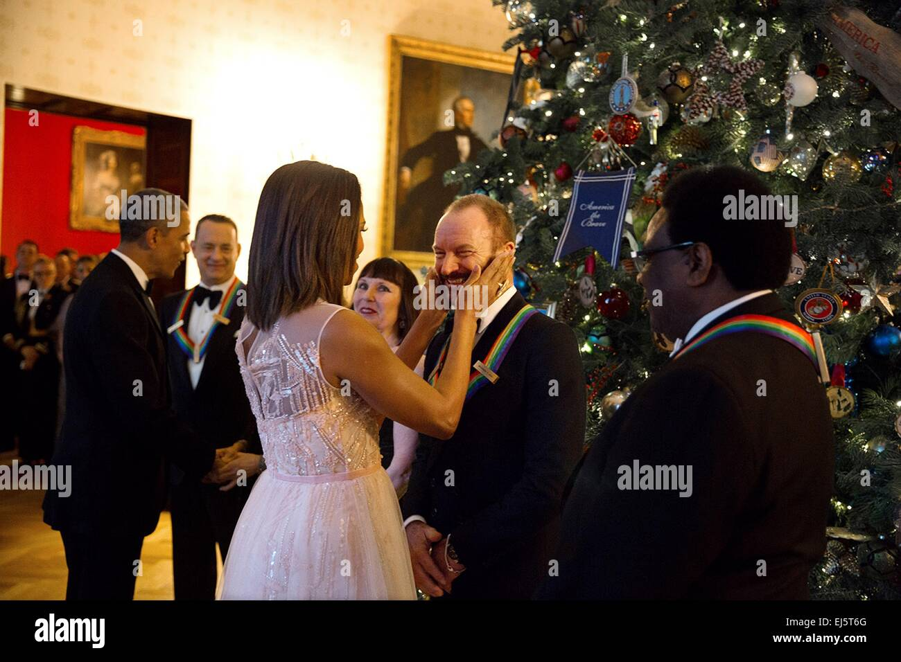 First Lady Michelle Obama greets musician Sting while President Barack Obama greets other honorees including Tom - Stock Image