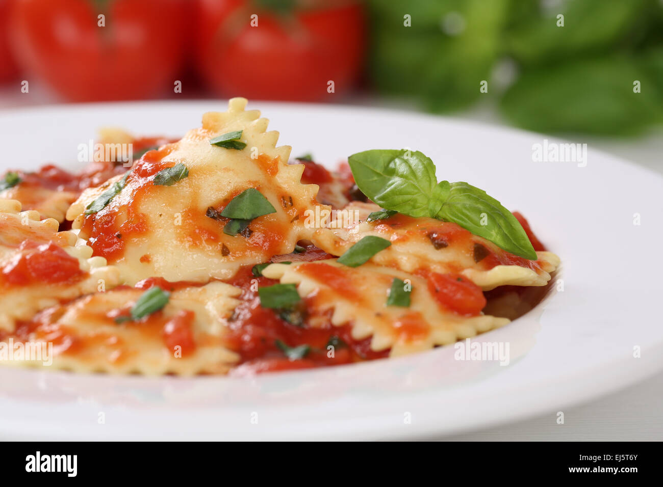 Italian Pasta Ravioli with tomatoes and basil meal on a plate - Stock Image
