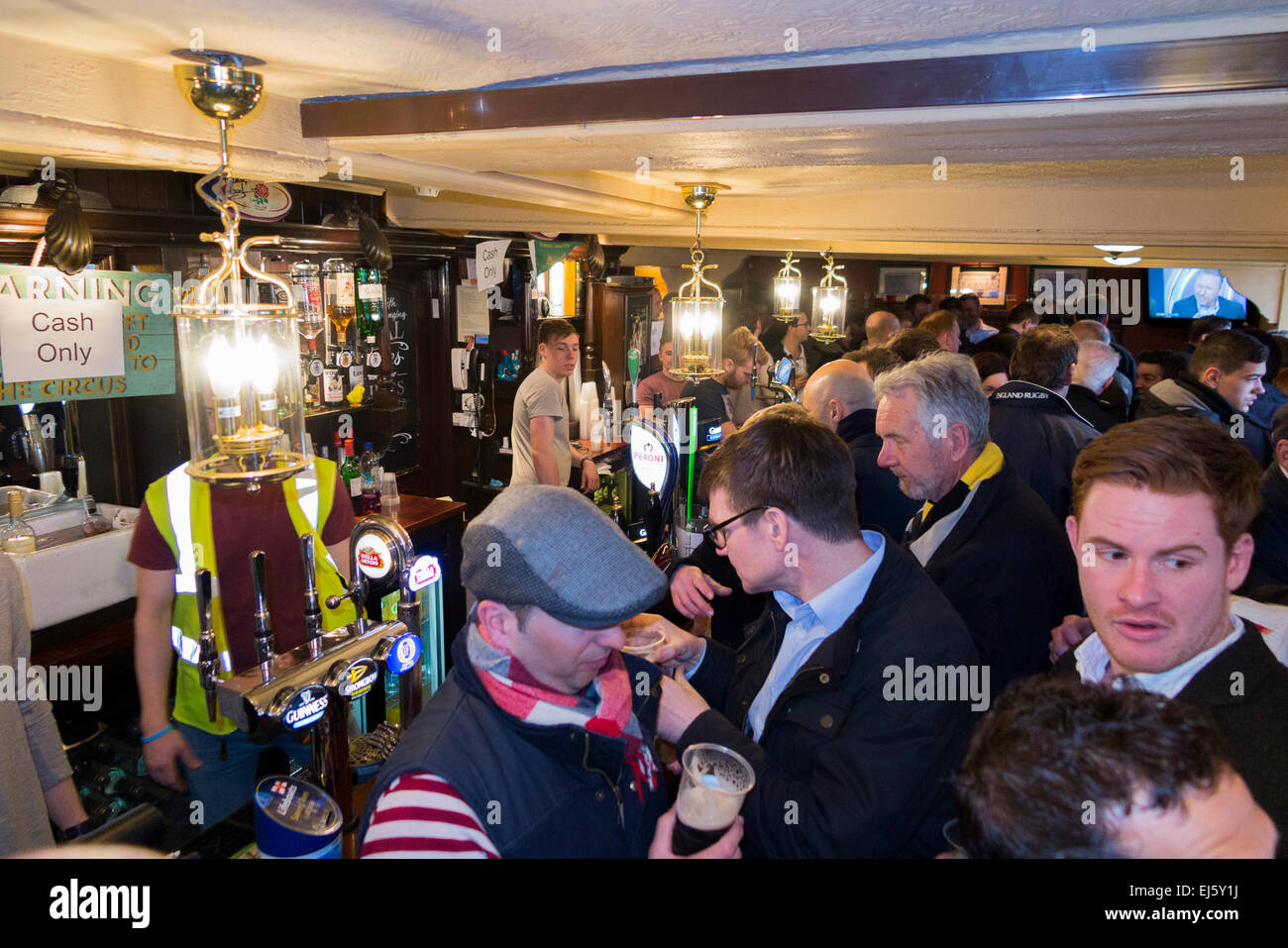 Rugby fan crowd / fans at crowded busy bar - The Barmy Arms pub / public house. Twickenham UK; popular on match Stock Photo