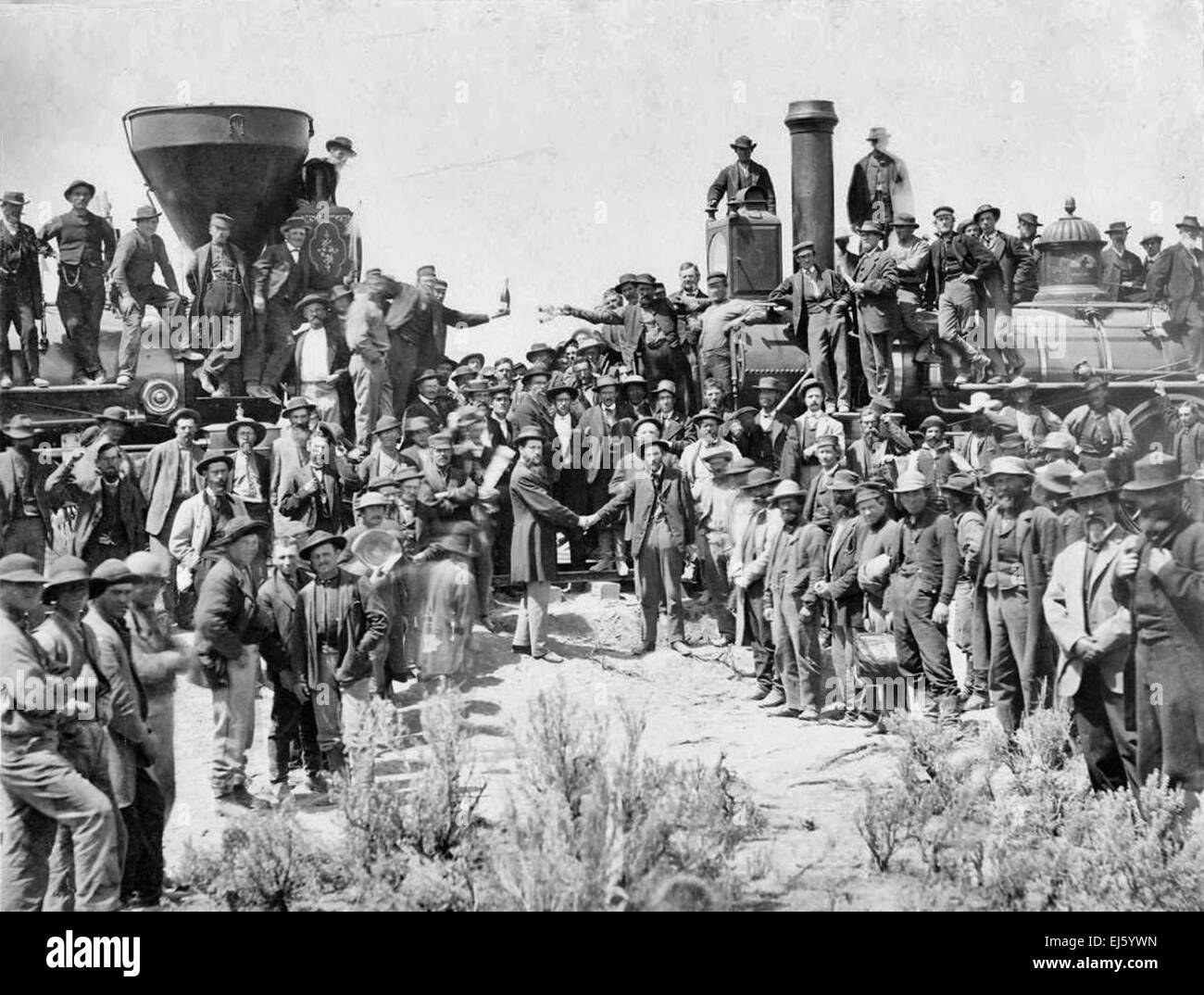 The ceremony for the driving of the golden spike at Promontory Summit, Utah on May 10, 1869; completion of the First - Stock Image