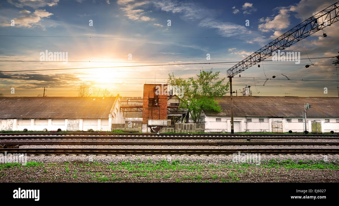 Rails and industrial station at the sunset - Stock Image