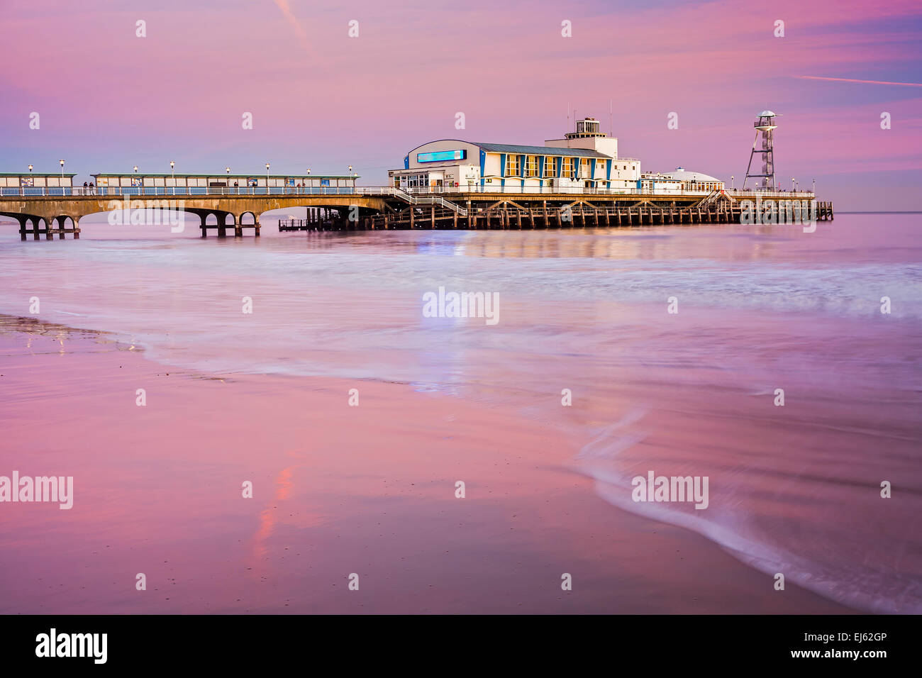 Bournemouth pier at Sunset from beach Dorset England UK Europe Stock Photo