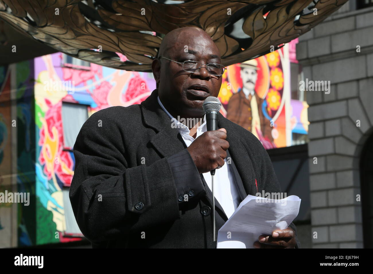 Sinn Fein Councillor Edmund Lukusa speaks during an anti-racism protest outside the Central Bank in Dublin - Stock Image