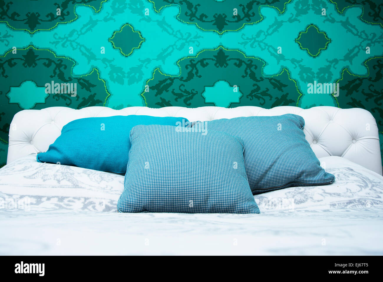 Bedroom design with colorful wallpaper and turquoise and white color ...