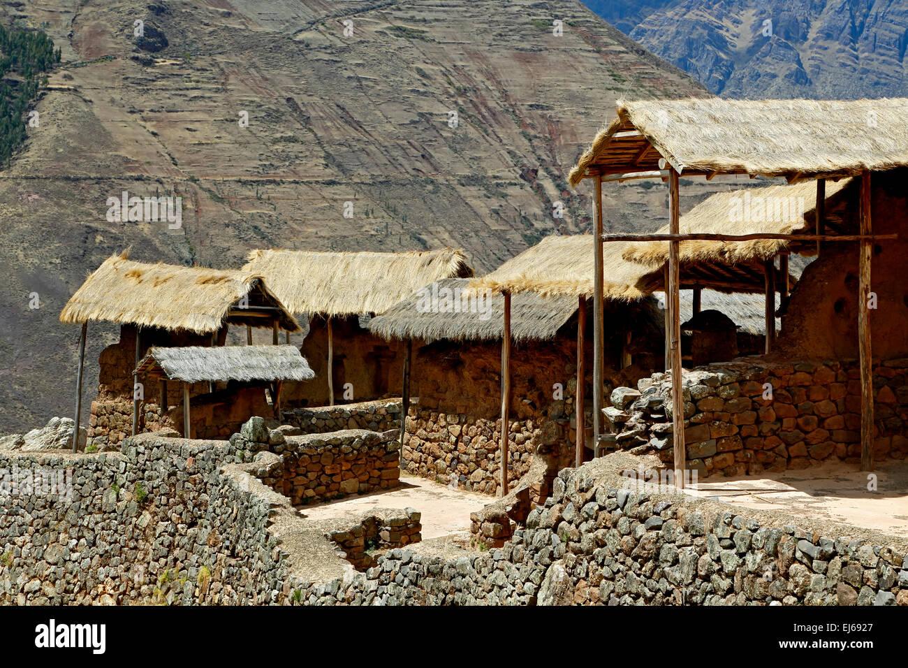Thatch roof-covered buildings, Pisac Inca ruins, Pisac, Cusco, Peru - Stock Image