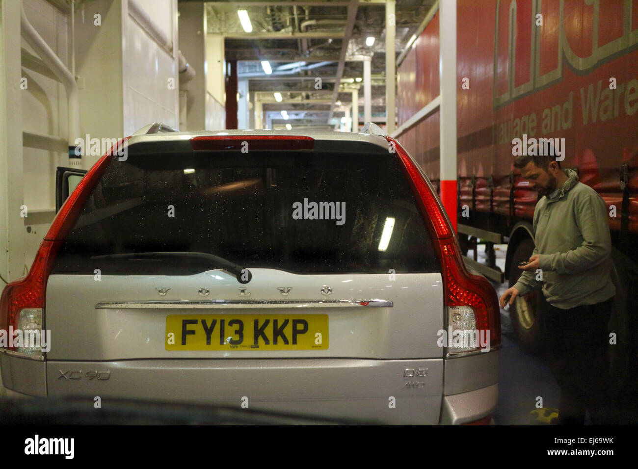 man locking car on ferry deck in the uk Stock Photo