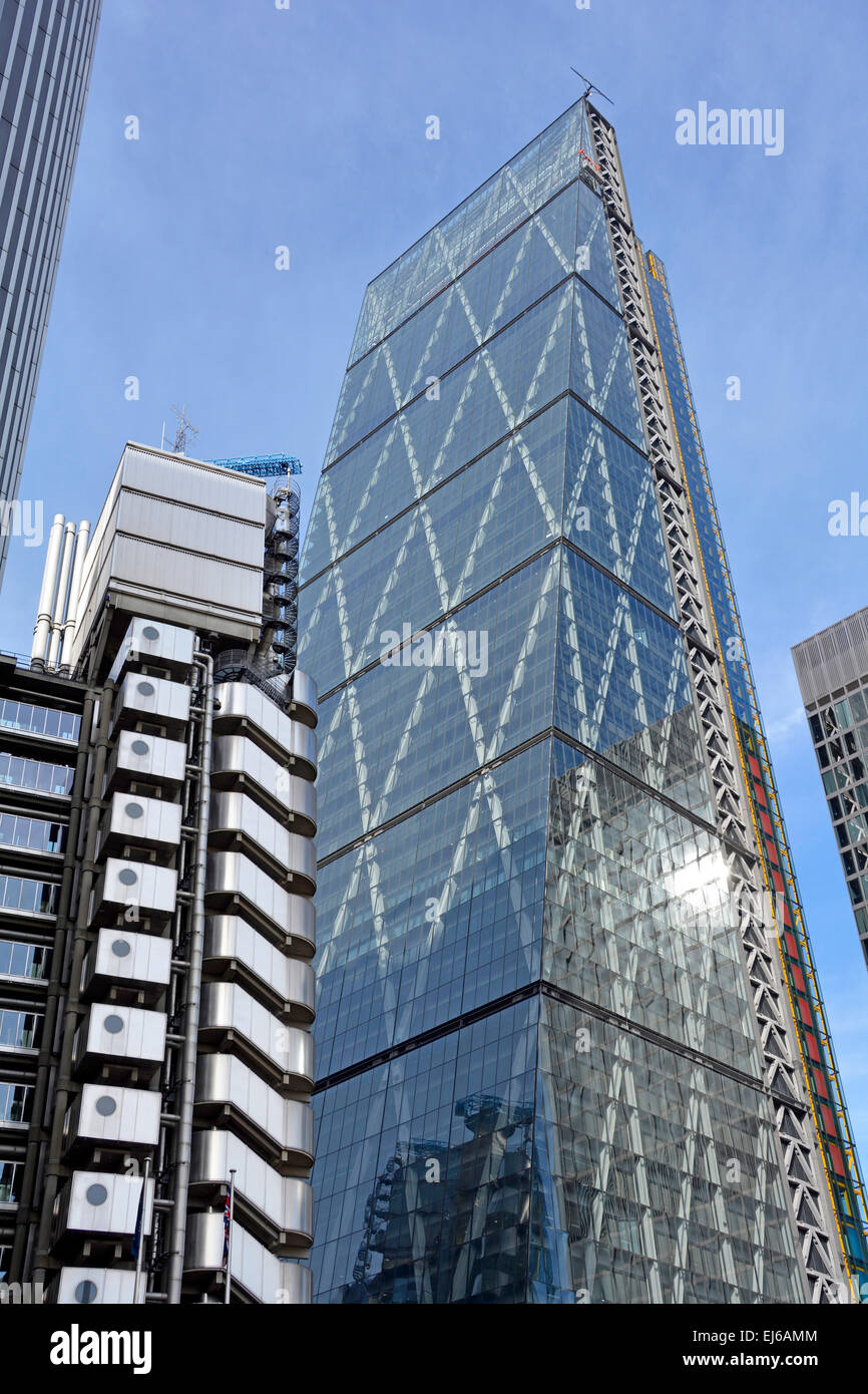The Cheesegrater skyscraper (also known as 122 Leadenhall Street) rises high above the nearby Lloyds of London building - Stock Image