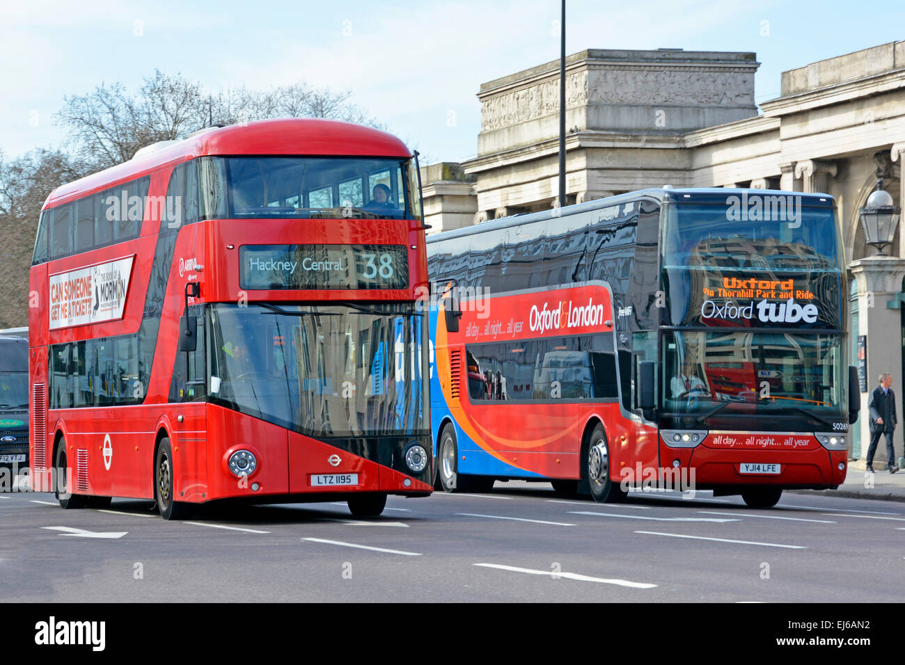 Regular London new Boris routemaster bus on local route 34 alongside inter city London to Oxford coach service run - Stock Image