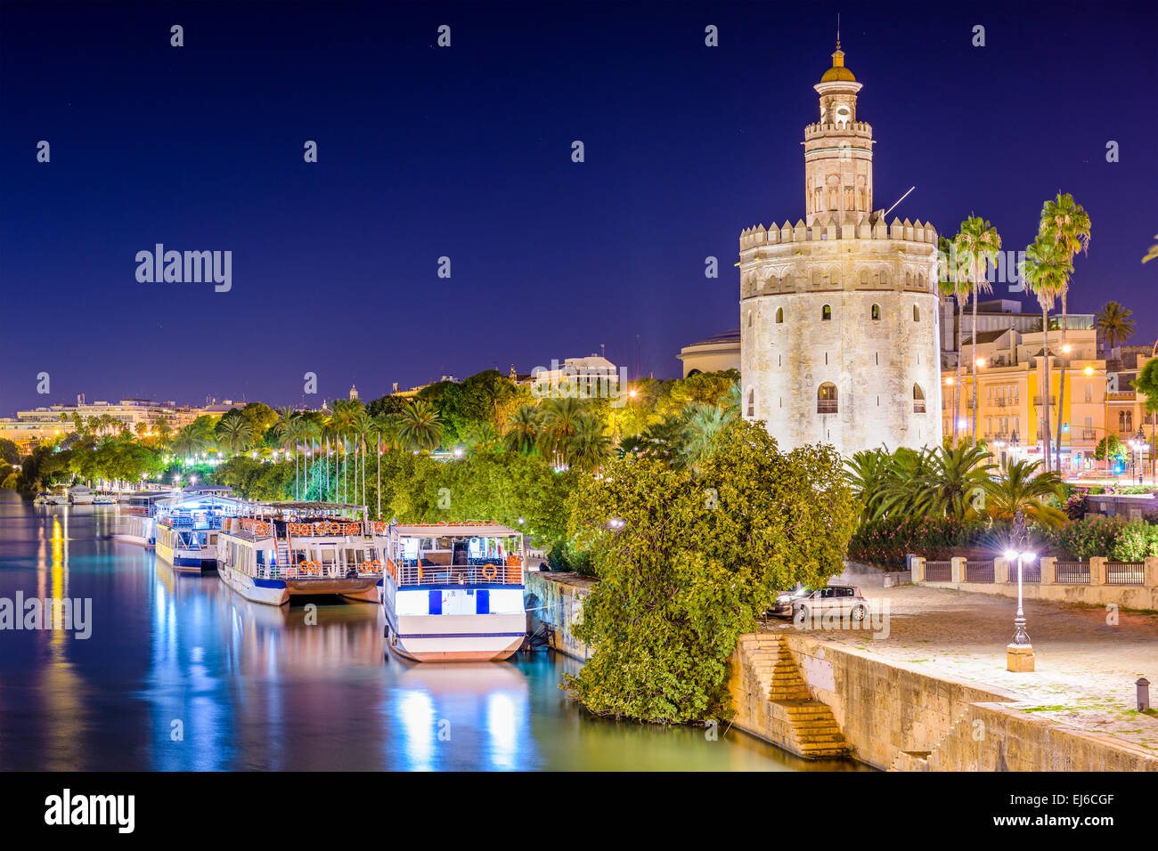 Seville, Spain at the Torre del Oro on the Guadalquivir River. - Stock Image