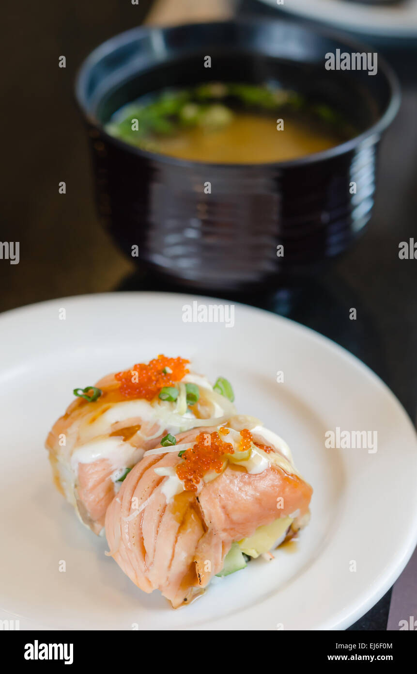 Grilled Salmon Roll Sushi With Shrimp Egg On Top In White Dish Served Stock Photo Alamy