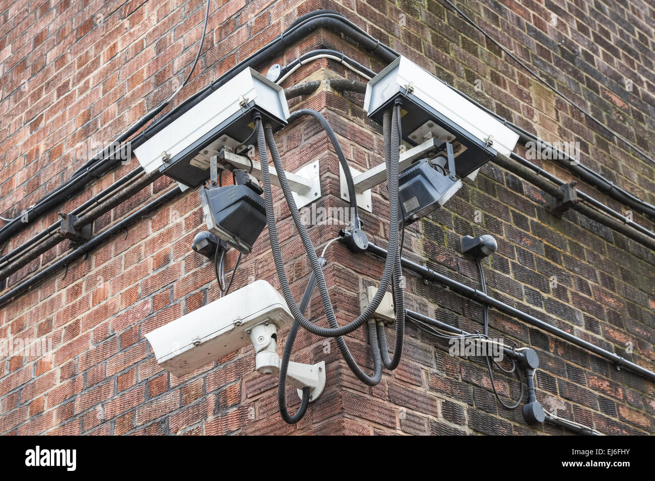 CCTV security cameras mounted on a brick building, London England United Kingdom UK Stock Photo