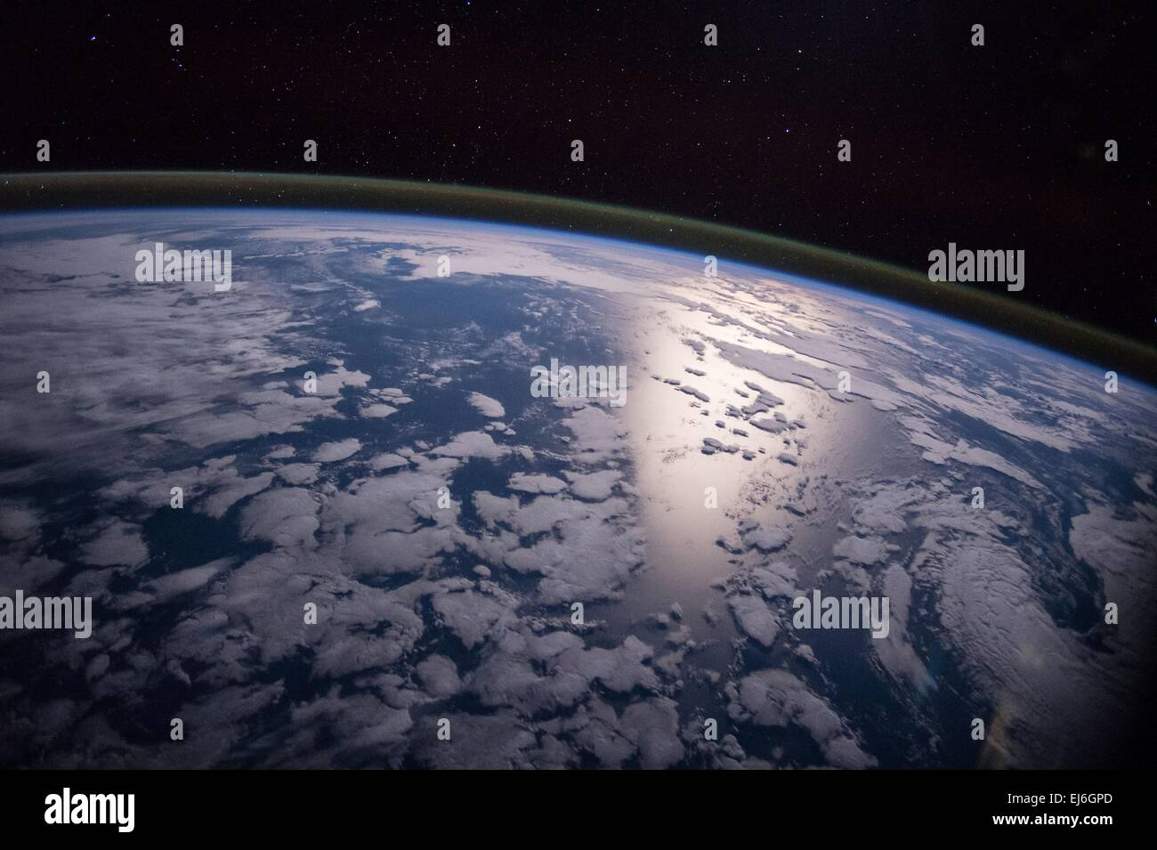 View from the International Space Station of a waning sun, splashing light across the planet March 3, 2015 in Earth - Stock Image