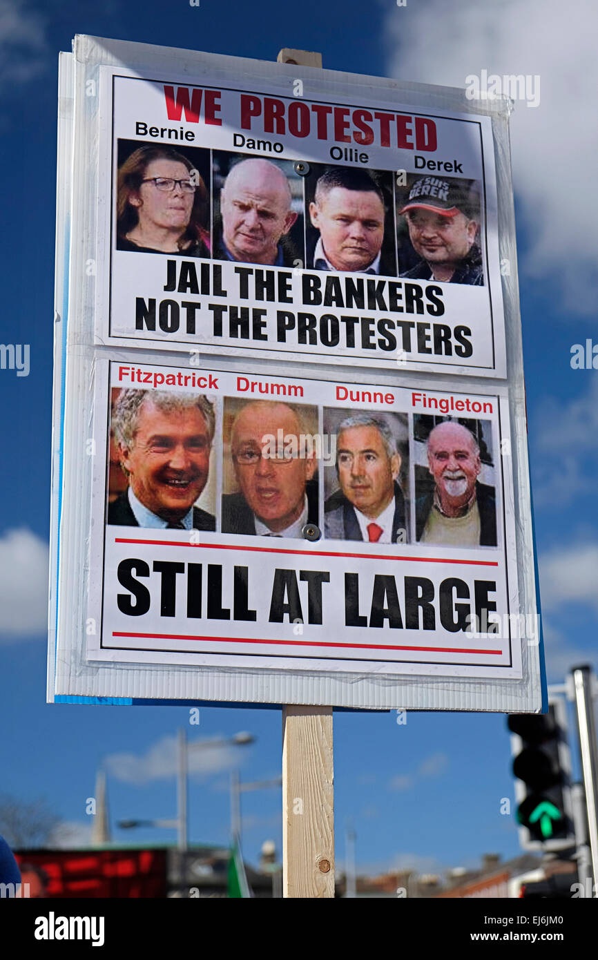 Poster showing jailed protestors and bankers, at Anti-water charges protesters in Dublin's O'Connell street - Stock Image