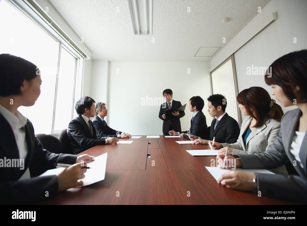 Japanese business people attending board meeting Stock Photo