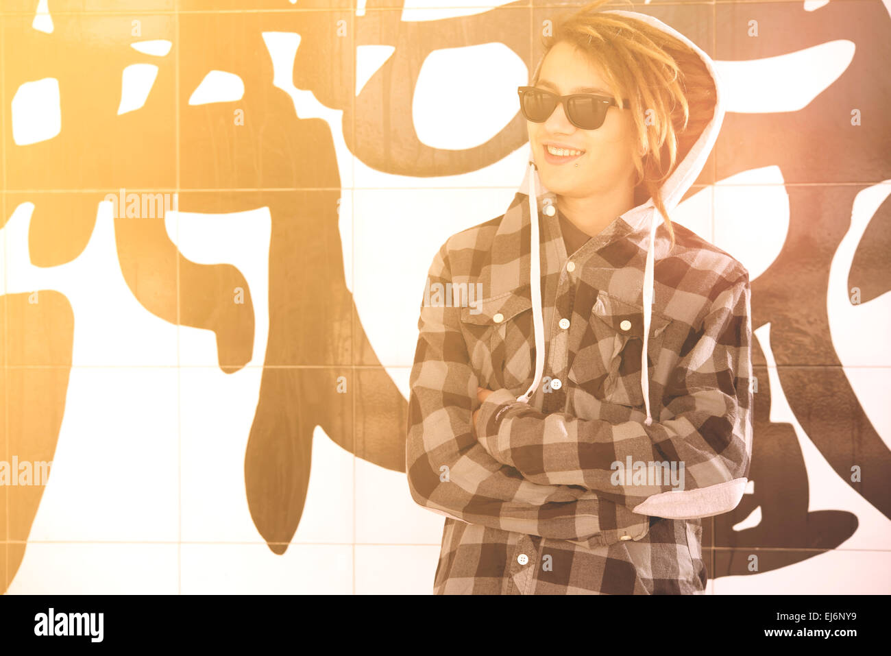 portrait of young guy  with rasta hair in a lifestyle concept warm filter applied - Stock Image
