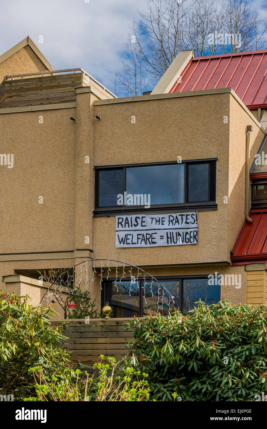 Sign on building saying raise the welfare rates. - Stock Image