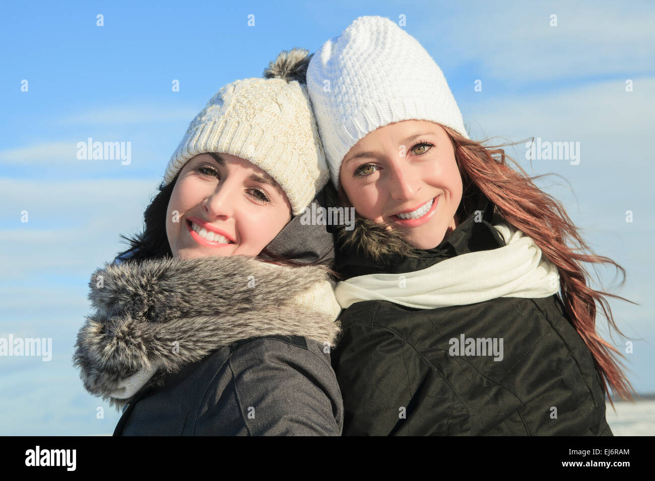 Two young girls having fun in winter park Stock Photo