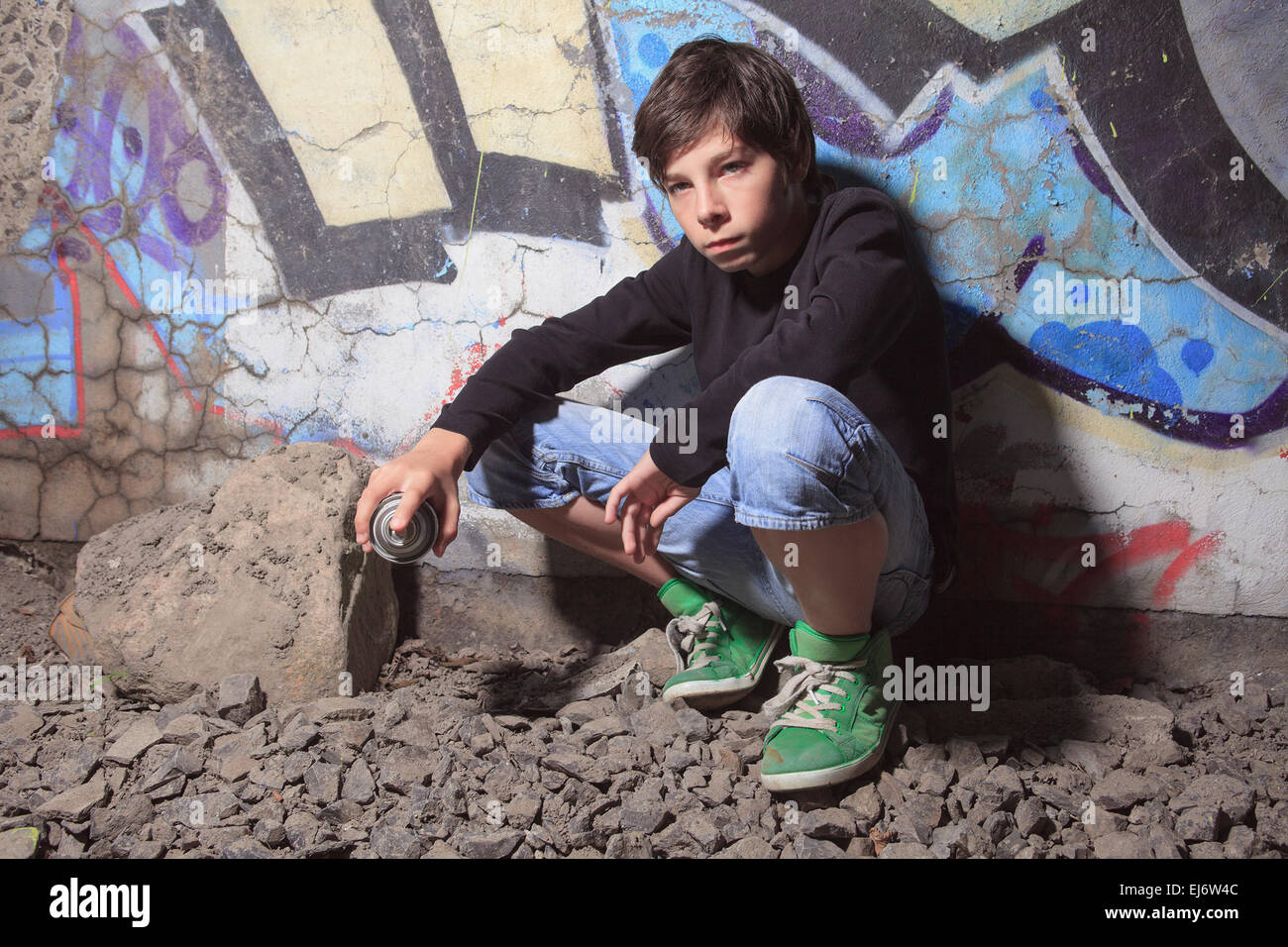 Teen made some graffiti on the wall of a tunnel - Stock Image