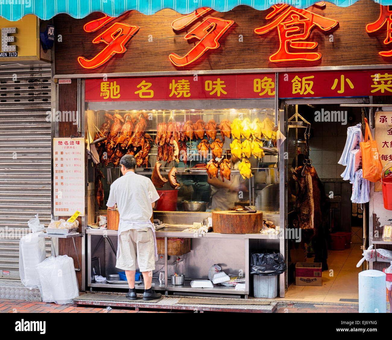 Hong Kong, Hong Kong SAR -November 12, 2014: Roast cantonese ducks and another rosted meat in a windows display - Stock Image