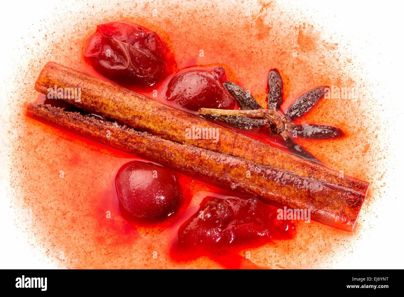 food dessert cherry cinnamon star anise smell taste sweet dessert compote translucent cinnamon stick completely - Stock Image
