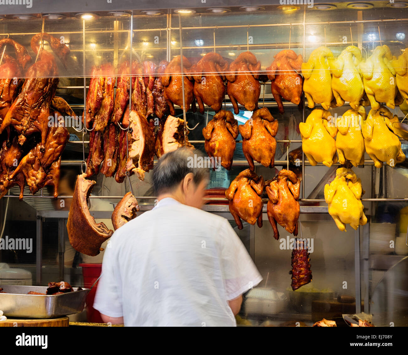 Roast cantonese ducks and another rosted meat in a windows display of a local eatery in Hong Kong. - Stock Image
