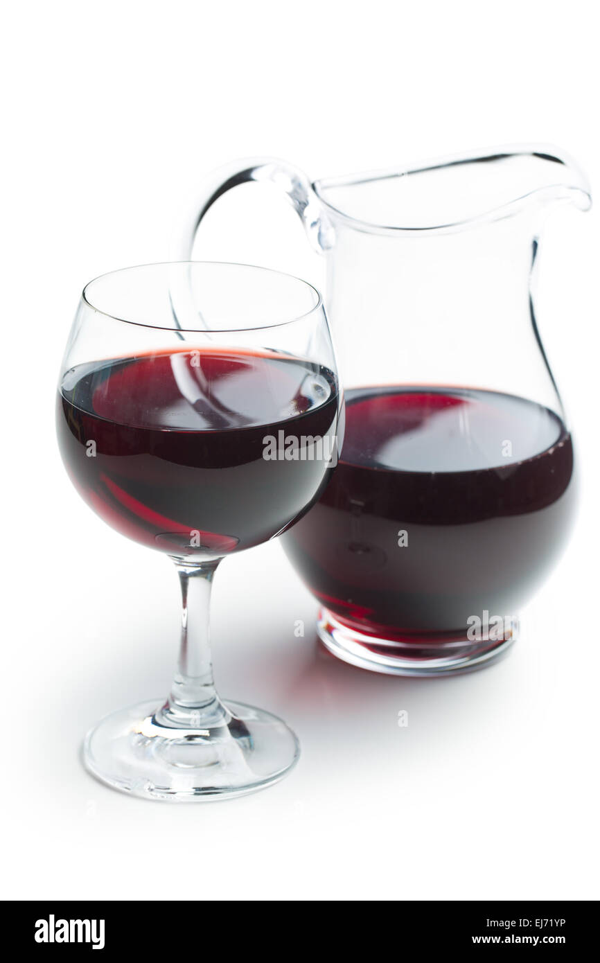glass of red wine with pitcher on white background - Stock Image