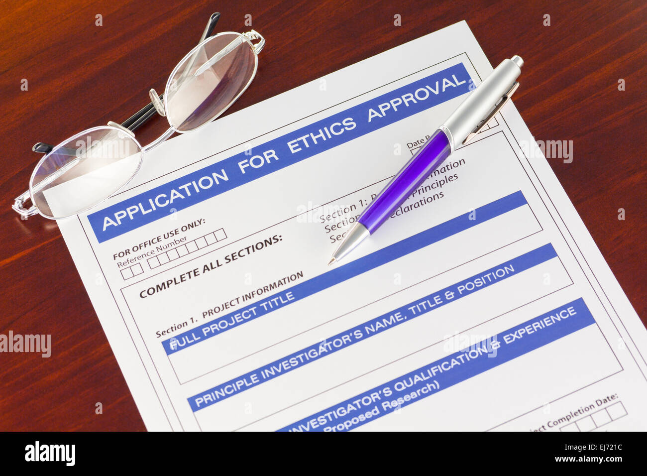 Application for Ethics Approval Form on Desk - Stock Image