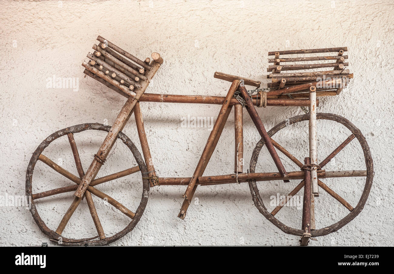 Wooden bicycle installation on a house wall, Kolfuschg, Province of South Tyrol, Italy - Stock Image