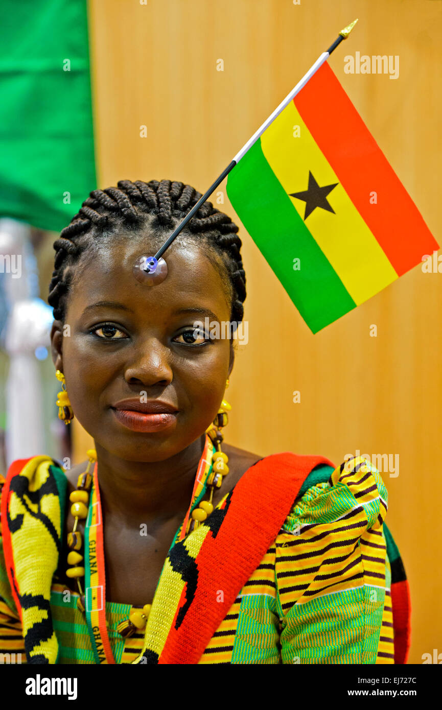 Young woman from Ghana displaying the national flag of her country on her forhead, Ghana - Stock Image