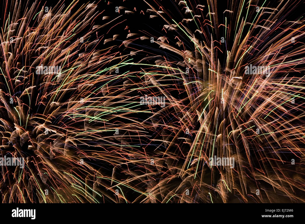 Red, orange, green and purple fireworks in the night sky, Montreal, Quebec, Canada - Stock Image