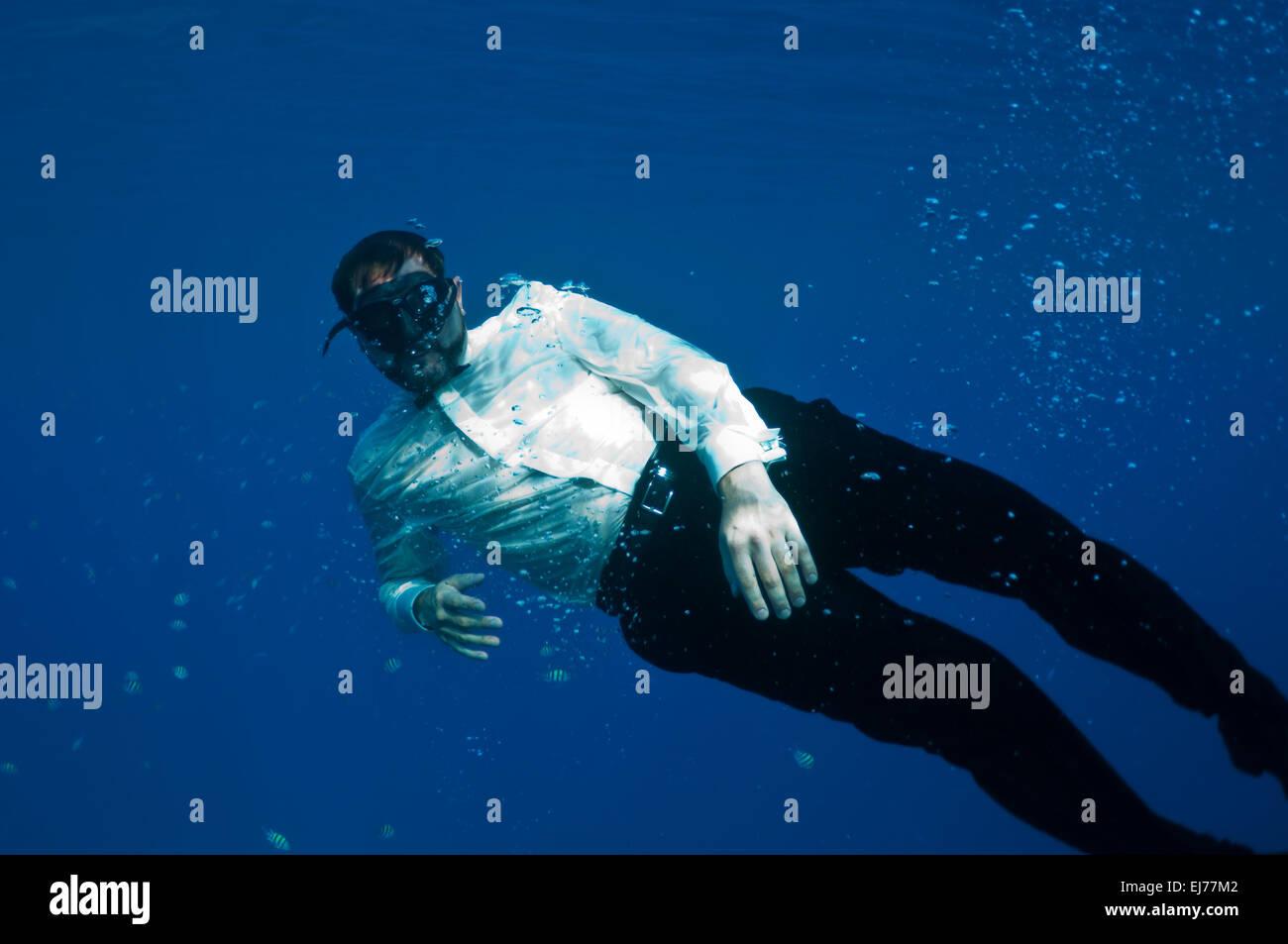 bizarre underwater men - Stock Image