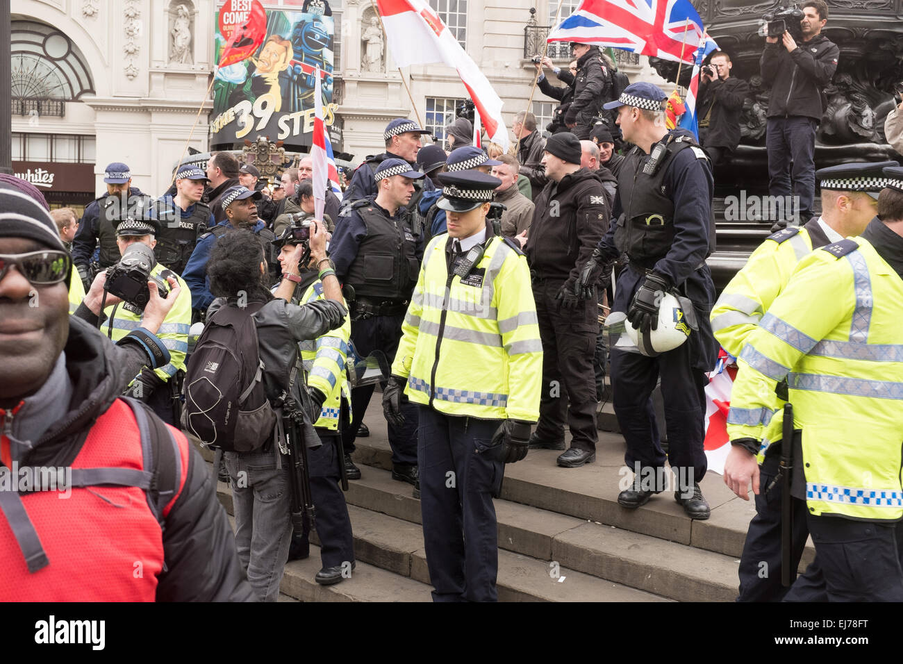 An Anti-racism Demo in London, 21st March 2015. Paul Golding of Britain First pictured on the steps of Eros at Piccadilly Stock Photo