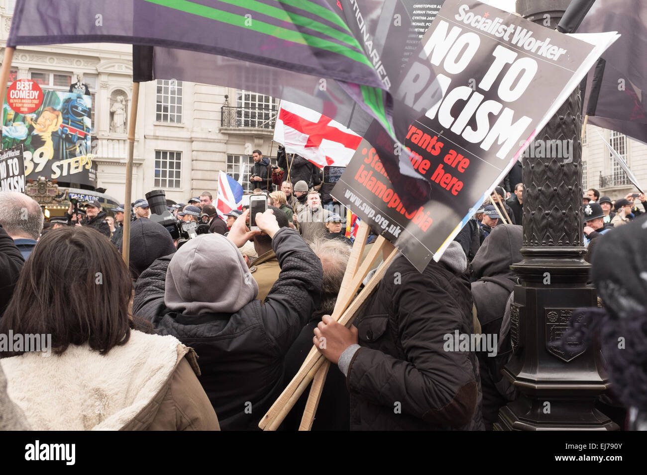 An Anti-racism Demo in London, 21st March 2015. Paul Golding of Britain First pictured on the steps of Eros at Piccadilly - Stock Image