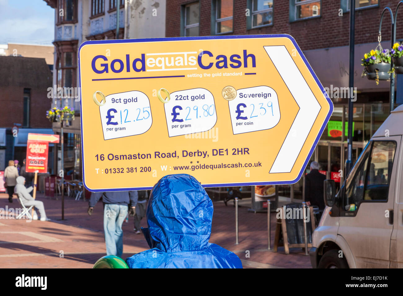 Low paid jobs. Unskilled worker working as a sign waver. Person holding an advertising board for Gold Equals Cash, - Stock Image