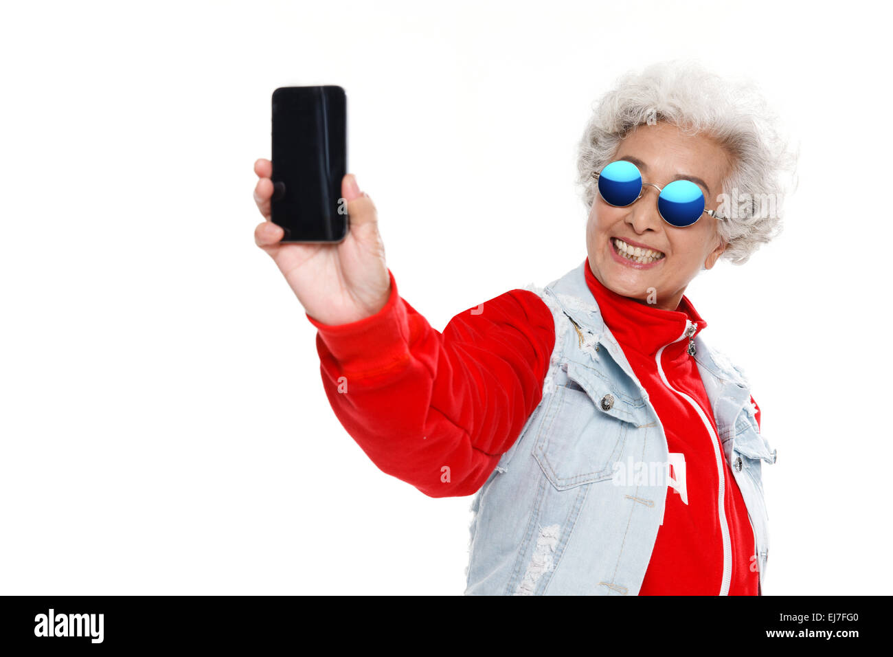 Fashion old people holding a mobile phone - Stock Image