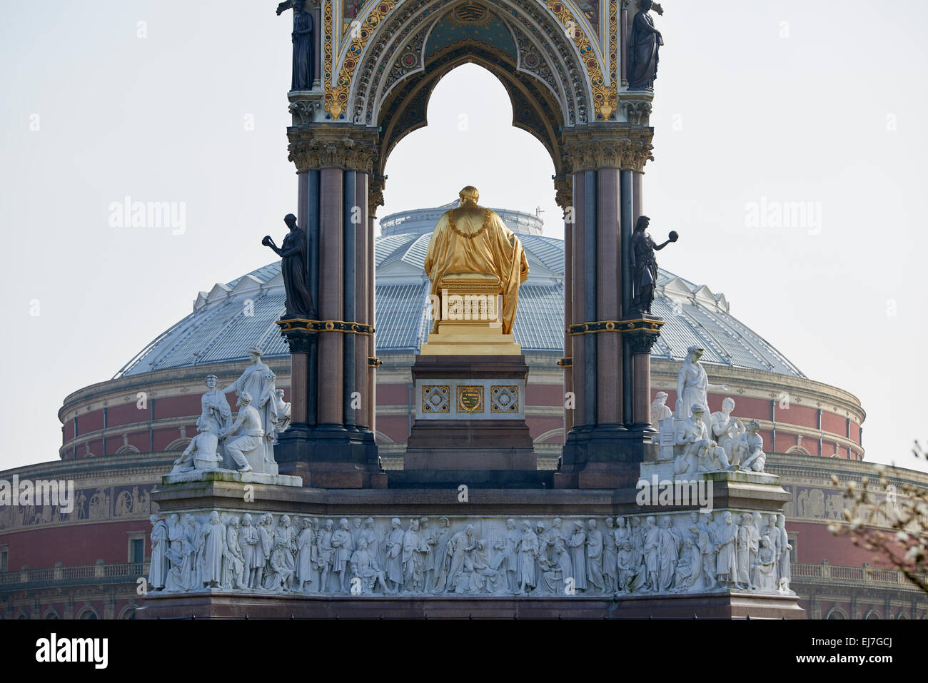 Albert Memorial statue overlooking hazy Royal Albert Hall, in London. The memorial was commissioned by Queen Victoria - Stock Image